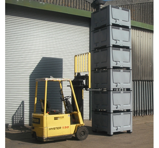 Jumbo sized containers known as pallet boxes stacked and moved by forklift truck