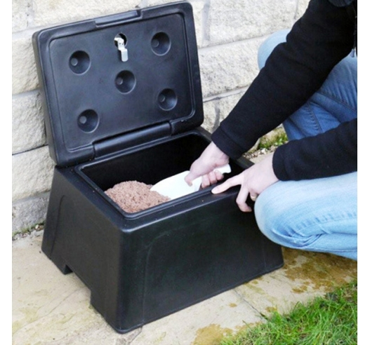 Mini grit bin in garden