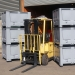 Pallet boxes stacked and moved by forklift truck